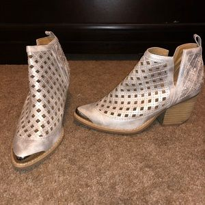 Silver booties from local boutique